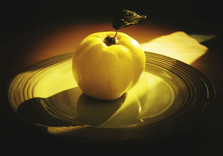 Close-Up Of Yellow Fruit In Plate On Table