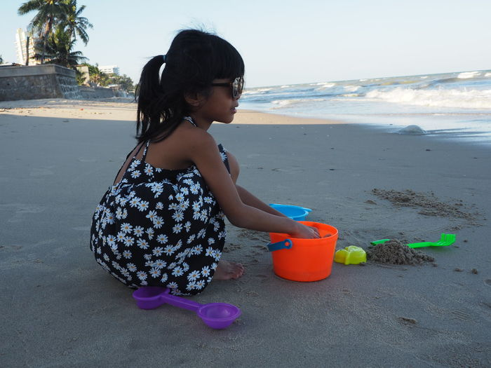 Girl with toy on beach