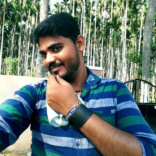 Mettupalayam One Man Only Only Men One Person Adults Only Outdoors Adult One Young Man Only Day Young Adult Portrait Human Body Part People Casual Clothing Young Men Men Sunlight Shadow Lifestyles Tree Human Hand