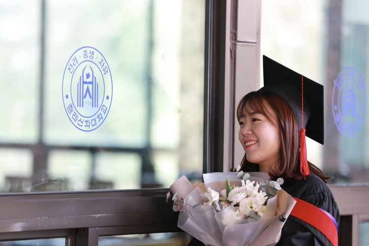 Graduation Happy One Girl Only People Real People Smile Window