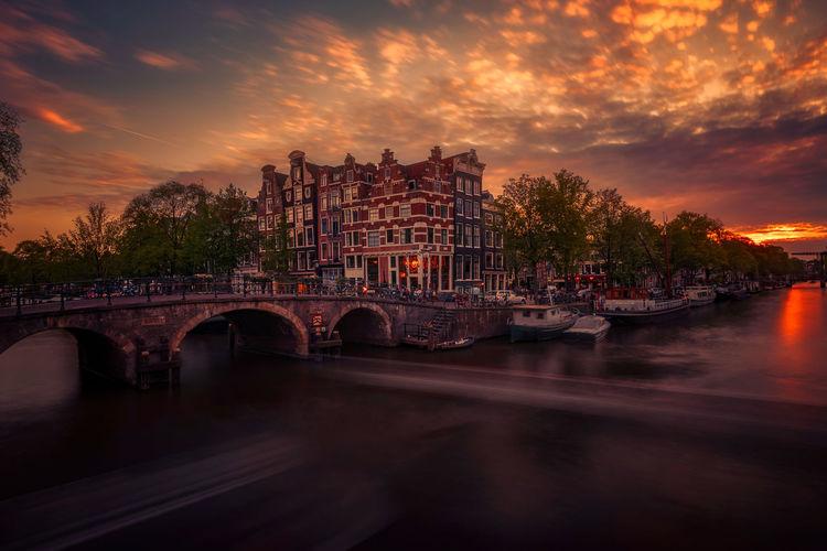 Get my all new Amsterdam 2019 Lightroom Presets for just €9,- and get the all new Zaanse Schans 2019 for free ! ;-) And there is still the discount of a big 80% on everything in the webshop happy 2019 everybody ! !! :-) remoscarfo@icloud.comwww.remoscarfo.com Water Sky Architecture Cloud - Sky Built Structure Transportation River Bridge Building Exterior Nautical Vessel Sunset Bridge - Man Made Structure Connection Nature Mode Of Transportation Reflection City Waterfront No People Arch Bridge Arch Outdoors Passenger Craft Cityscape Amsterdam