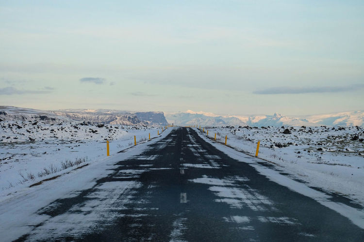 Scenic View Of Road Through Landscape During Winter