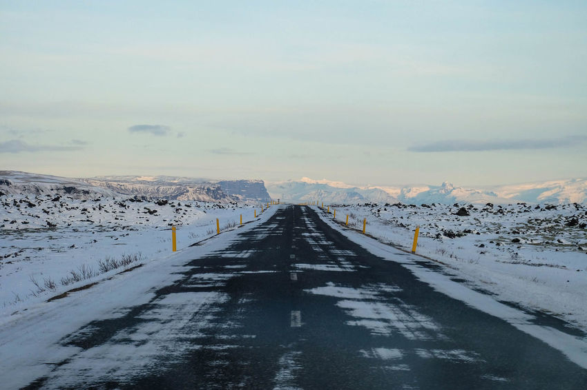 Beauty In Nature Cold Temperature Day Empty Road Iceland Mountain Nature No People Outdoors Road Road Trip Scenics Sky Snow Snowing Straight Tranquility Travel Weather Winter