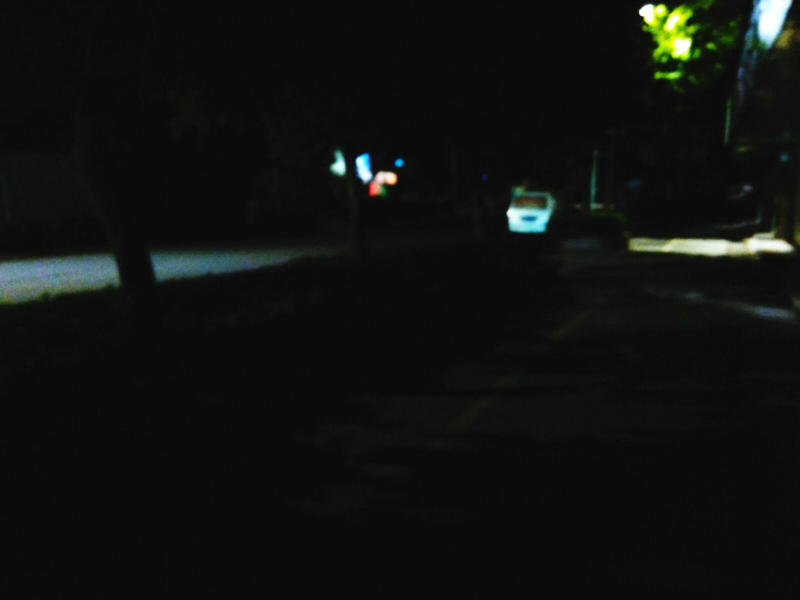 night, transportation, illuminated, street, car, land vehicle, road, mode of transport, dark, tree, street light, the way forward, silhouette, outdoors, empty, no people, road marking, city, lighting equipment, incidental people