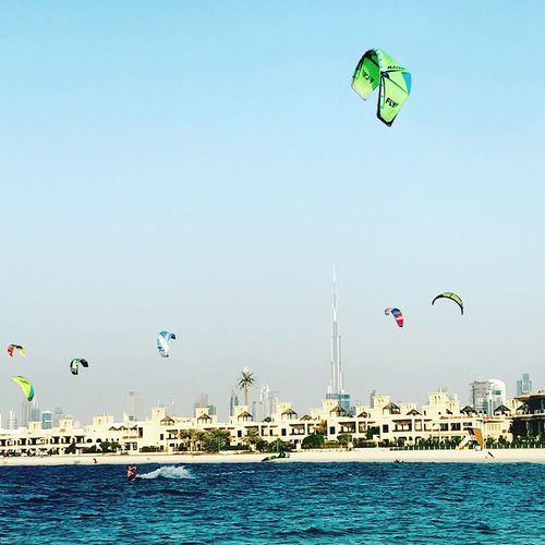 Kitesurfing in Dubai, Kite Beach, United Arab Emirates 🇦🇪 Water Mid-air Sea Clear Sky Day Outdoors Nature Waterfront Sky Leisure Activity Adventure Blue Real People Flying Parachute Built Structure Lifestyles Architecture Beauty In Nature Building Exterior Kites Ocean IPhone Photography Activity Beach