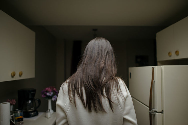 Rear view of woman at home