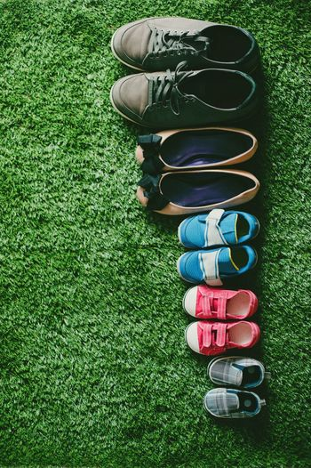 Directly above shot of shoes on field