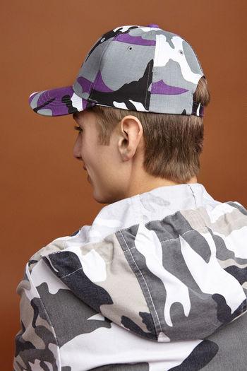 Portrait of boy wearing hat against wall