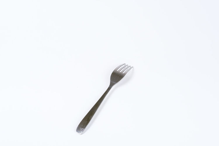 Eating Equipment Food Fork Garpu Kitchen Utensil Utensils Studio Shot White Background Copy Space Single Object Indoors  Still Life Cut Out Kitchen Utensil Metal Eating Utensil No People Close-up High Angle View Work Tool Dental Health Directly Above Two Objects Silver Colored Dental Equipment Steel