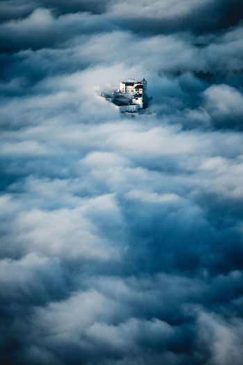 Low angle view of ship sailing in sea against sky