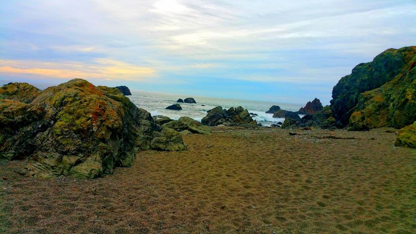 An Endless Sea Zen Serene Contemplating Copy Space Distance Depth Horizon Over Water Rule Of Thirds Nirvana Peaceful Timeless Meditation Sand Beach Stone Brown Multi Colored Outcropping Natural Color Red Rock Nature's Colors Contrast Unusual Tranquil Scene Nature Rock - Object Scenics Cloud - Sky Landscape No People Outdoors Sea Sky Beach Tranquility