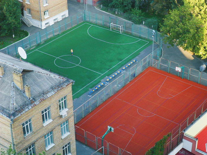 High angle view of soccer field and buildings