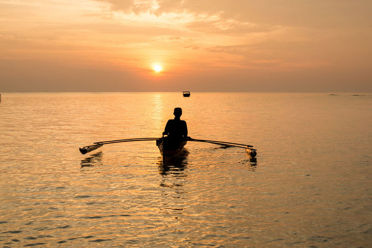 sunrise with fsherman. Sunset Water Sky One Person Sea Orange Color Nautical Vessel Scenics - Nature Silhouette Beauty In Nature Waterfront Horizon Over Water Transportation Tranquility Real People Tranquil Scene Nature Horizon Men Sun Outdoors Paddling