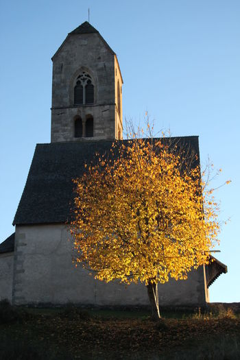 Architecture Autumn Autumn 2016 Blue Sky Building Exterior Built Structure Church Church Tower Clear Sky Day Fiè Allo Sciliar Italy No People Orange Color Outdoors Religion Roof Sunset Südtirol Tree
