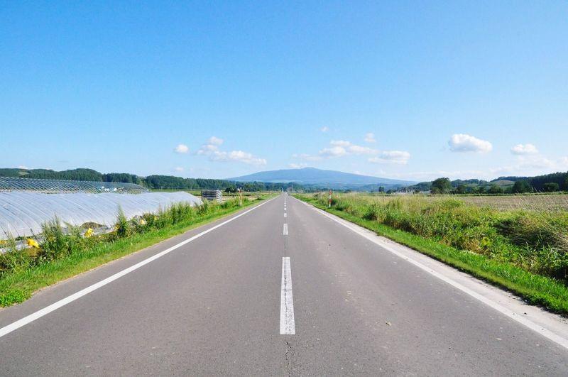Empty road against sky at hokkaido island