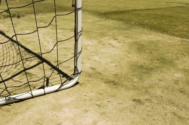 Cropped image of soccer goal on field at playground