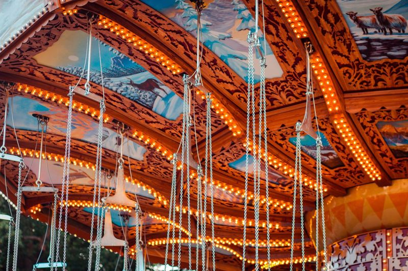 Low angle view of illuminated carousel in amusement park