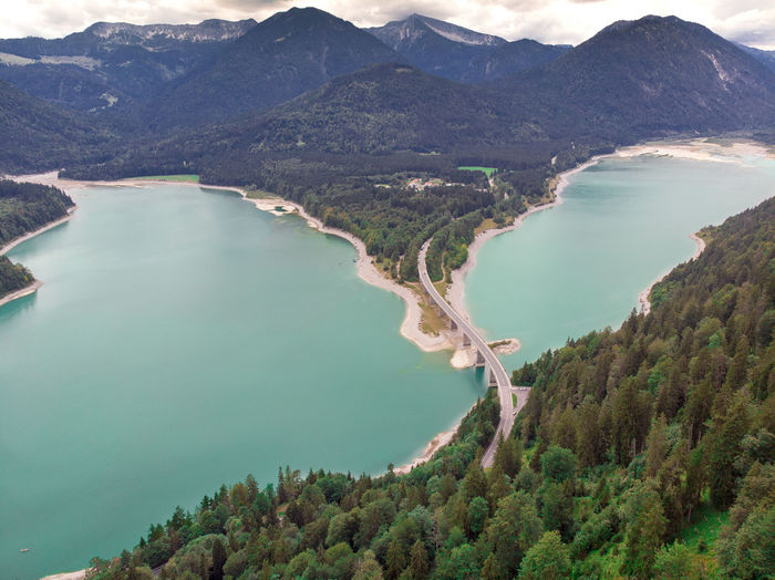 High Angle View Drone Point Of View Lake Landscape Non-urban Scene Bavarian Alps Aerial View Mountain Tranquil Scene Forest Water Bridge - Man Made Structure The Way Forward Direction Copy Space Tranquility Tree Nature Environment Mountain Range Lake View Outdoors Day Idyllic Majestic Majestic Nature EyeEm Nature Lover