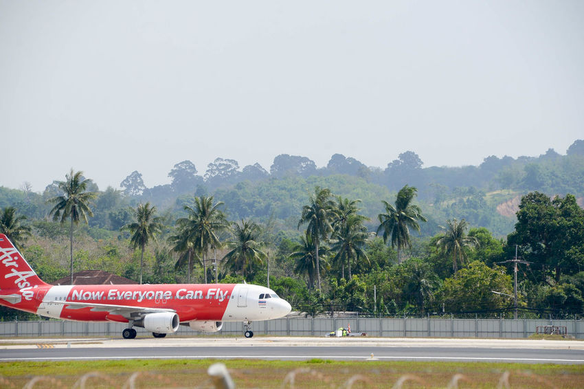 air plane Air Asia Airport Runway Day Engine Flying Jet Landing No People Outdoors Phuket Phuket Airport Plane Red Sky Transportation Travel