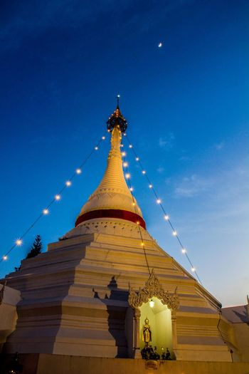 Low angle view of pagoda against blue sky