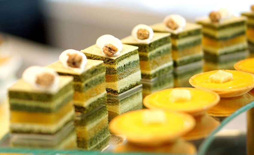 Line of dessert buffet coloful sweets cake beautifully display on top