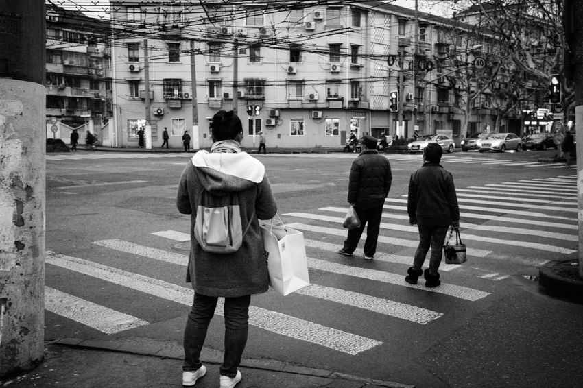 City Architecture Crosswalk Street Building Exterior Full Length Road Marking Walking Transportation Road Zebra Crossing Built Structure Crossing Rear View Real People City Life Marking Symbol Men Day City Street Streetphotography Blackandwhite