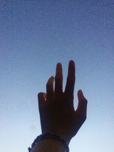 Photo by me 📸👏🏼🤞🏼 Human Hand Human Body Part Human Finger One Person Silhouette Gesturing Low Angle View Sky Blue Day Real People Outdoors Palm People Close-up Adult Life