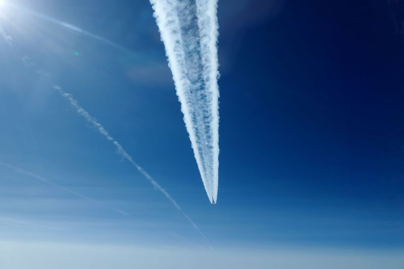 Vapor Trail Cloud - Sky Sky Air Vehicle Airplane Low Angle View Flying Smoke - Physical Structure Transportation Motion Mid-air Plane Mode Of Transportation Nature on the move Blue No People Day Outdoors Speed