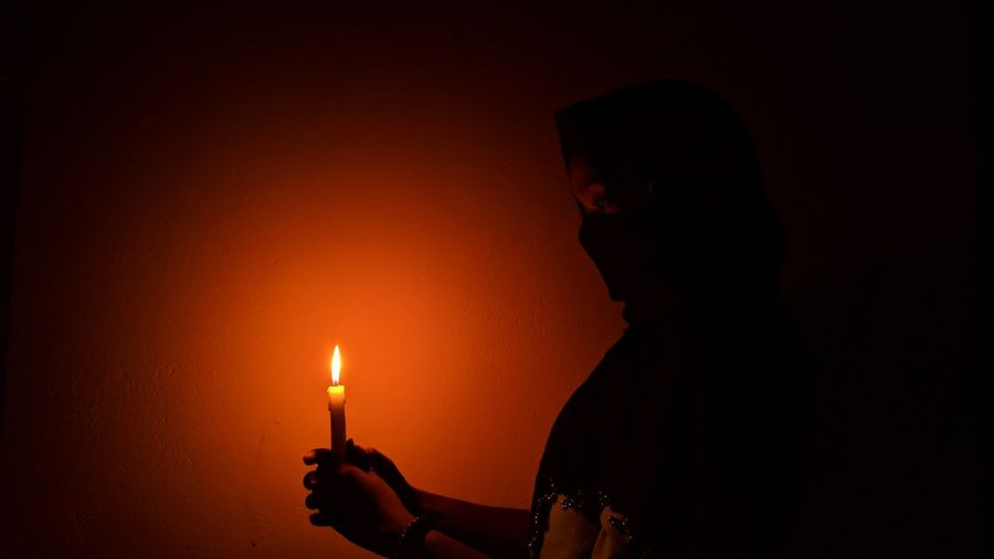 Girl with the light EyeEm Best Shots EyeEm Selects EyeEmBestPics Nightphotography Shadows & Lights Human Hand Illuminated Photography Themes Flame Heat - Temperature Silhouette Burning Holding Close-up Candlelight Candle Darkroom