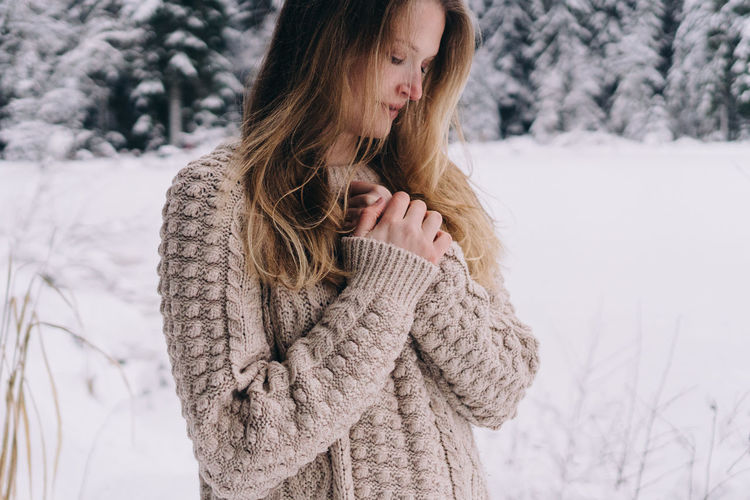 Woman in snow covered land