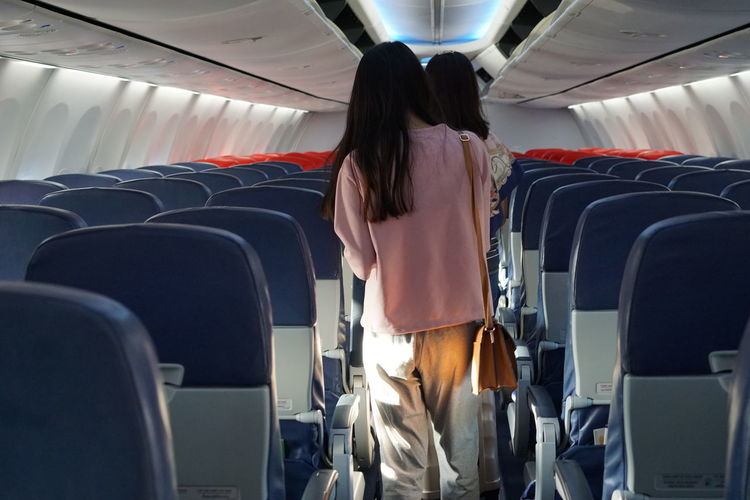 Airplane Aerospace Industry Commercial Airplane Air Vehicle Young Women Flying Standing Airport Travel Passenger Train Airport Departure Area Airplane Seat Arrival Departure Board Vehicle Seat Cabin Crew Passenger Cabin Wheeled Luggage Co-pilot Airport Terminal Private Airplane First Class Moving Walkway  Moving Walkway  Metro Train Vehicle Interior Corporate Jet Airport Check-in Counter Train Interior Passenger Boarding Bridge Laundromat