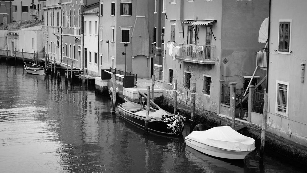 Private parking Canal Travel Water Tourism Building Exterior Outdoors No People Day Blackandwhite Italy Veneto Chioggia Ancient Boats Parking Windows Stillness Archaic Simple Things No Rush Take A Break EyeEm Best Shots EyeEm Gallery Eye4photography  Gondola - Traditional Boat