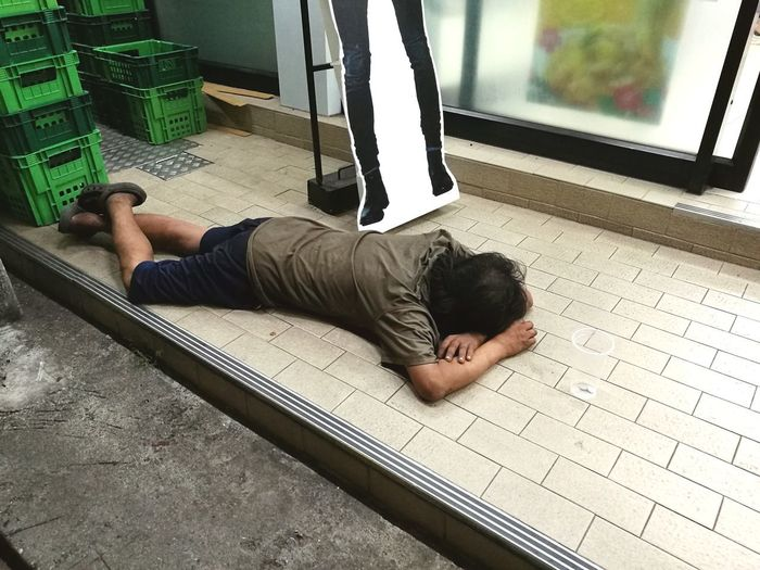 sleeping outside supermarkets Sleeping Outdoors Outdoors Outdoor Photography One Person Night Men Lying Down