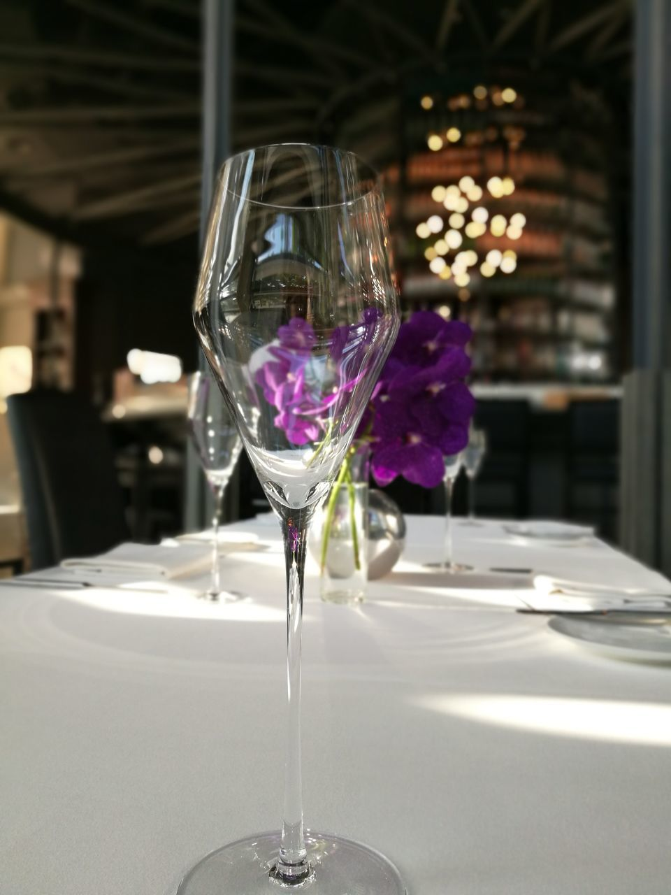 glass, indoors, wineglass, table, transparent, focus on foreground, glass - material, food and drink, close-up, freshness, refreshment, drink, no people, alcohol, restaurant, wine, household equipment, drinking glass, business, luxury, purple, setting