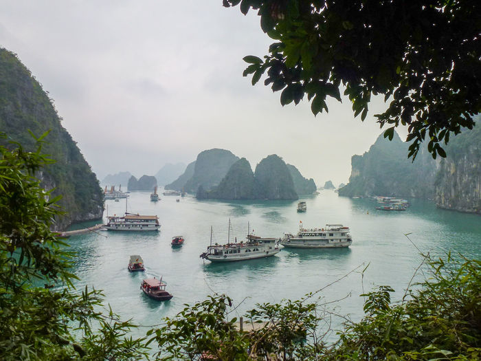 View of boats in Ha Long Bay Beauty In Nature Mode Of Transport Mountain Nautical Vessel No People Outdoors Sea Transportation Vietnam Water