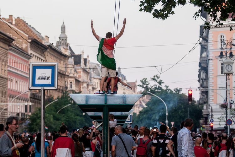 People At Town Square Against Sky