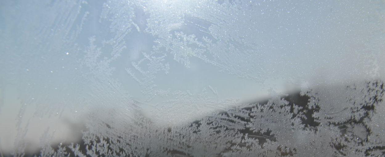 Full frame shot of wet glass window during winter