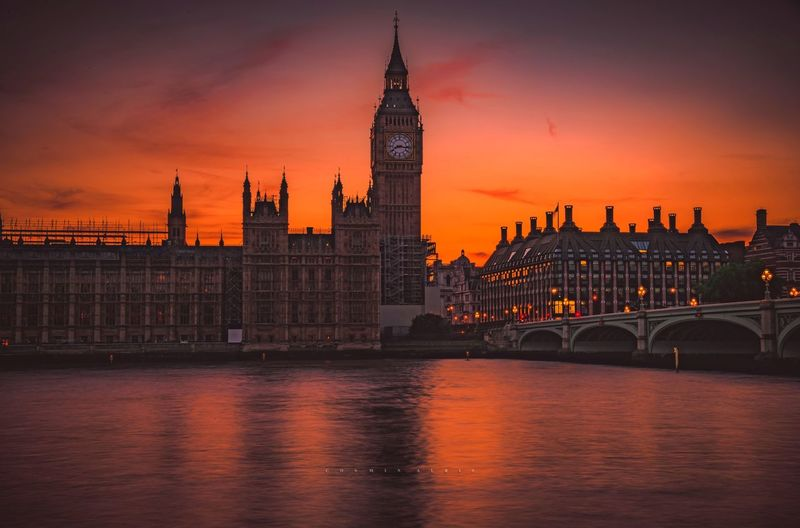 Palace of Westminster Parlament Clock Tower Thames River Colours Clouds And Sky Westminster Palace Of Westminster Big Ben London Thames River Built Structure Architecture Building Exterior City Water Building Clock Tower Tower Sky Travel Destinations Sunset River Nature Waterfront Bridge Government
