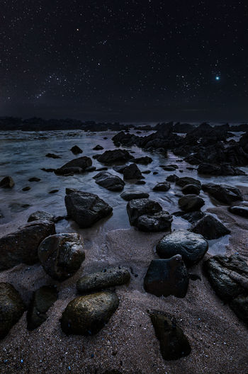 """Night Wonders"" The brightest spot at the lower right in the sky is Jupiter. Astronomy Beach Beauty In Nature Clear Sky Coastal Coastline Constellation Dark Dawn Landscape Nature Night Nightphotography No People Ocean Outdoors Scenics Sea Seascape Shore Sky Space Star - Space Star Field Universe"