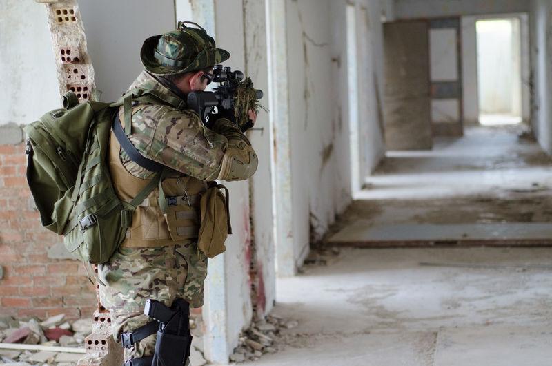 Army solider shooting in corridor