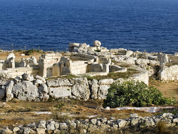 Mnajdra Megalithic Temple Mnajdra Mnajdra Temple, Malta Ancient Ruins Approx. 3000 BC Ancient Ancient Civilization Architecture Building Exterior Built Structure Castle Day History Megalith Megalithic Megalithic Structure Nature No People Old Ruin Outdoors Sea Water Weapon