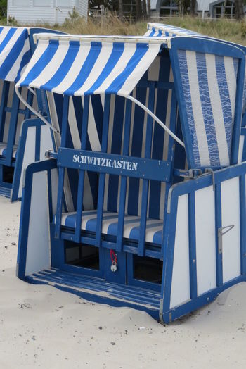 "Strandkorb ""Schwitzkasten"" Beach Beach Chair Blue And White Day Empty Nature No People Outdoors Sand Sunny Sweating Cure"
