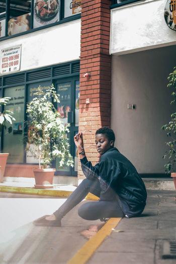 Portrait EyeEm EyeEm Best Shots Fresh On Market 2018 Streetphotography Teenager Young Adult Africa Woman Fashion Street Sitting Outdoors City