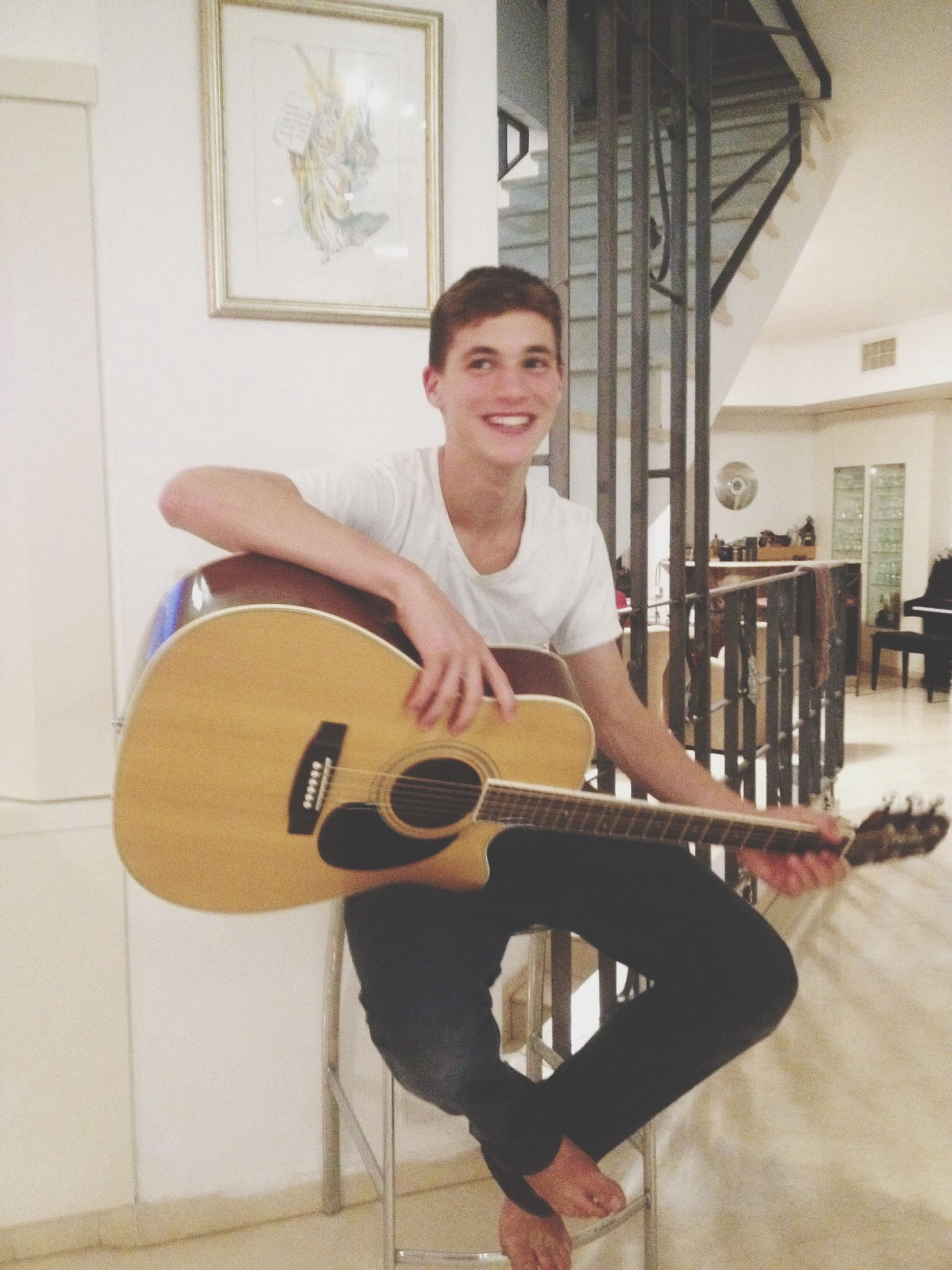 lifestyles, casual clothing, person, leisure activity, indoors, holding, front view, young adult, looking at camera, portrait, sitting, full length, young men, smiling, standing, three quarter length, happiness