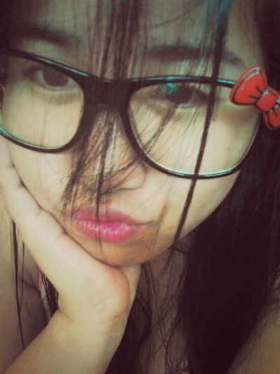 close-up photo with hello kitty eyeglasse. :'D