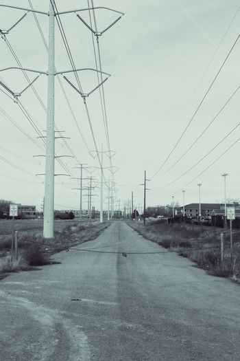 Dead End Power Line  Old Road Chained Up Black And White Closed Off Off Limits Stay Out Energy Power Company High Voltage Overhead Power Line Infrasttucture