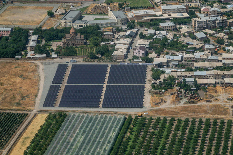 Aerial view of solar panel in agricultural field