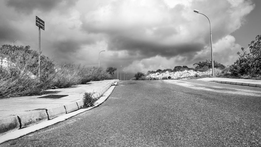 Road Sky Street Light Street Nature Cloud - Sky Plant Transportation Day No People Direction Sign Tree The Way Forward Road Sign Outdoors Beauty In Nature Lighting Equipment City Blackandwhite Black And White EyeEm EyeEm Best Shots EyeEm Selects