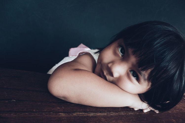 Portrait of cute girl lying down