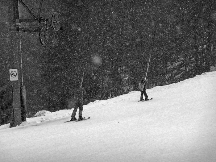 Four years old but not alone in the snowfall A Guide To The Extreme Present A Way Addiction Black & White Black And White Blackandwhite Easy Photography Fragility Learning Love Skiing Ski Instructor Ski Lift Skiing Snow Snowfall Storm Teaching Winter Snow Sports